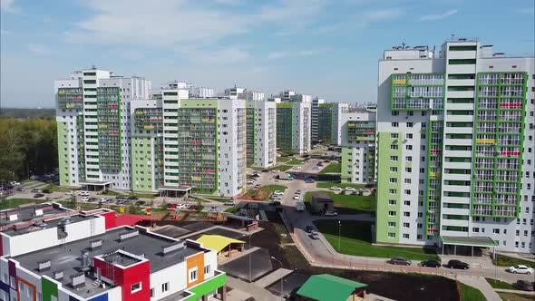 View of Modern Apartment Buildings and a Kindergarten with Bright Colorful Facades From a Bird's Eye
