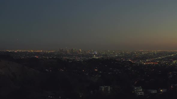 Thumbnail for AERIAL: Over Hollywood Hills at Night with View on Downtown Los Angeles View,