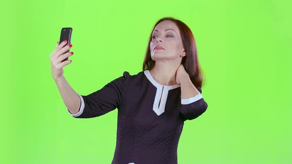 Thumbnail for Woman Makes Selfie on Her Phone. Green Screen