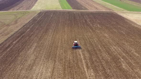 Thumbnail for Tractor Plowing the Land