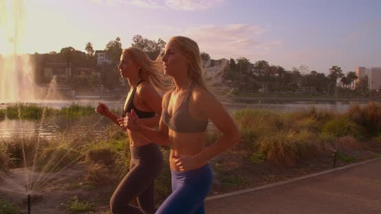 Thumbnail for Athletic Twins Running In The Park Slow-Motion
