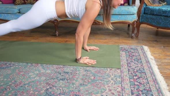 Young Attractive Female Doing A Pose On A Yoga Mat
