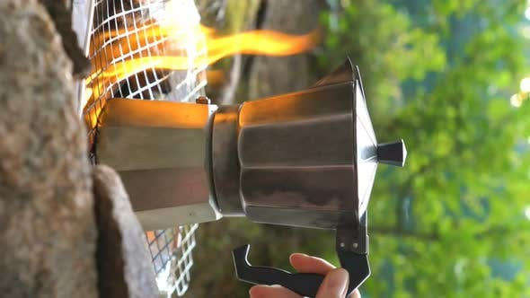 Thumbnail for Young Woman Making Coffee on Camp Fire with Moka Pot. A Vertical Video.