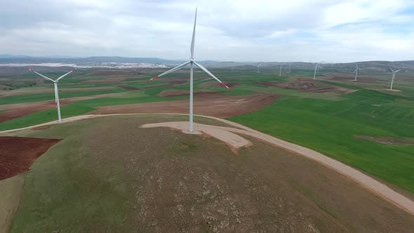 Thumbnail for Wind Power Plant on Edge of Brown Treeless Fields in Vast Plain
