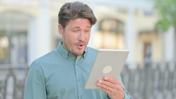 Video Call on Tablet by Man Outdoor