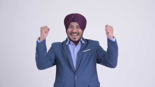 Thumbnail for Happy Bearded Indian Sikh Businessman Getting Good News