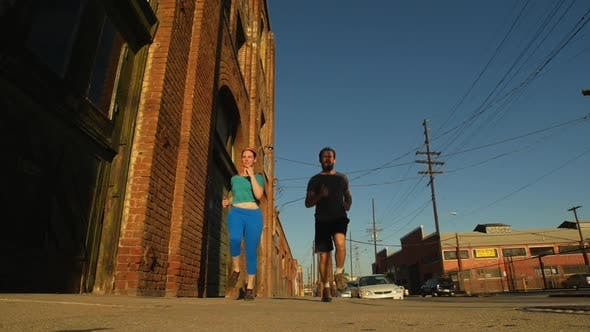 Thumbnail for A couple running and working out together in urban environment