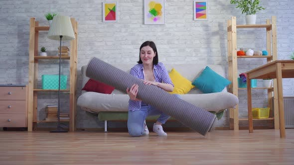 Young Woman Brings a New Carpet
