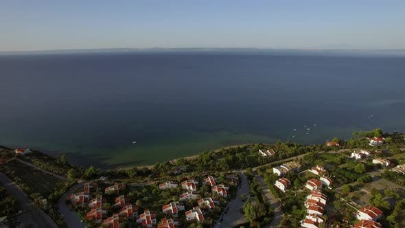 Thumbnail for Flying Over Town on Waterfront and Blue Sea. Trikorfo Beach, Greece