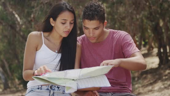 Thumbnail for Mexican couple reading a map outdoors