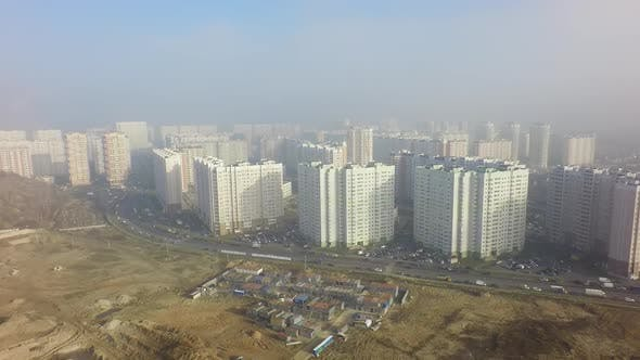 Thumbnail for An Aerial View of a Large Construction Site and a Residential Area Behind It