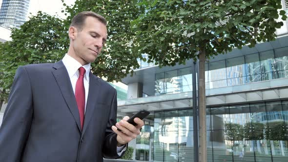 Thumbnail for Businessman Using Smartphone