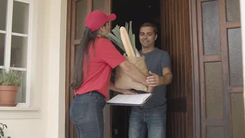 Food Courier Knocking at Door
