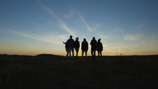 Thumbnail for Group of Chilling Friends in Nature in Twilight