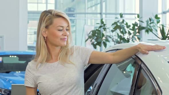 Happy Female Driver Showing Car Keys To Ker New Automobile