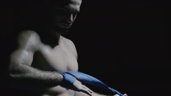 Thumbnail for Shirtless Fighter Taking Off Wrist Straps