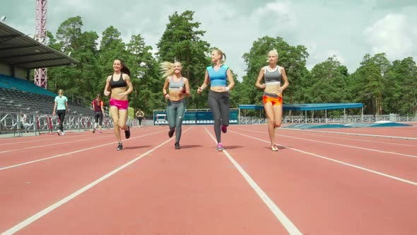 Cover Image for Sporty Women Jogging on Track