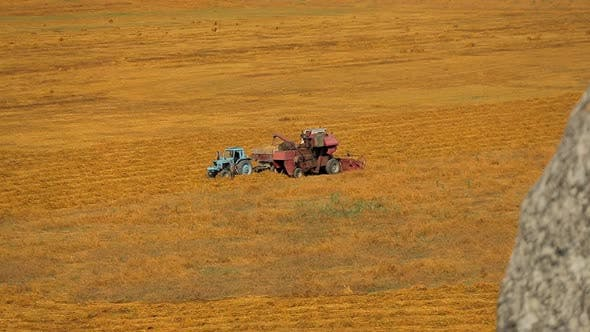 Thumbnail for Combine Filling Tractor With Grain At Field