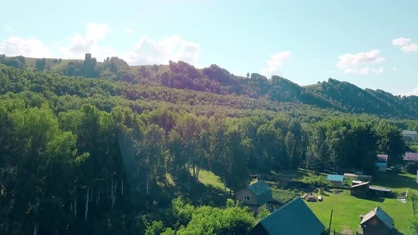 Aerial Shot Top View of the Tourist City Mountains Pine and Deciduous Forest Mountain River 2