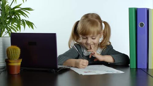 Online Learning, Distance Education, Lesson at Home. Girl Doing School Program Online on Computer