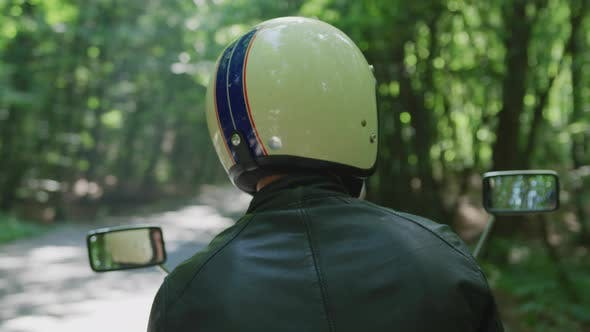 Thumbnail for Rear view of a man with a motorcycle helmet