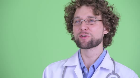 Thumbnail for Face of Happy Young Bearded Man Doctor Thinking