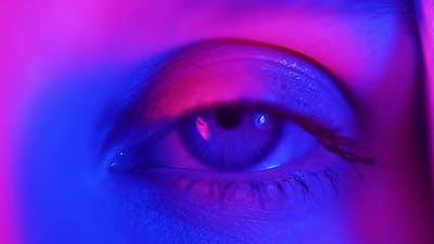 Extreme Close Up of Human Eye Iris Under Neon Light