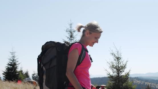 Thumbnail for Woman Hiking in Mountains with Backpack, Enjoying Her Adventure. Slow Motion