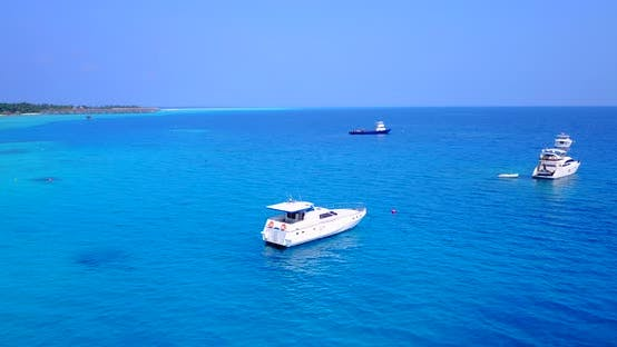 Thumbnail for Wide angle birds eye copy space shot of a sunshine white sandy paradise beach and blue water backgro