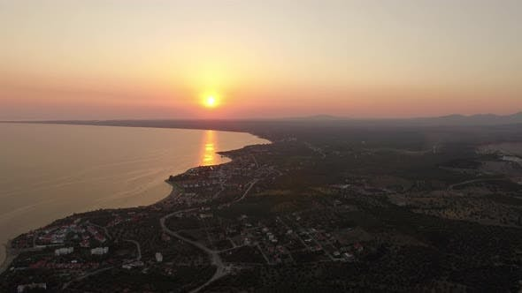 Thumbnail for Flying Over Coastal Trikorfo Beach at Sunset, Greece