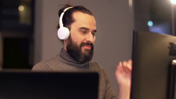 Thumbnail for Man in Headphones Working with Computers at Office 32