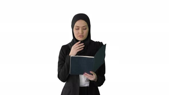 Thumbnail for Muslim Businesswoman Reading Her Business Planner While Walking To the Meeting on White Background