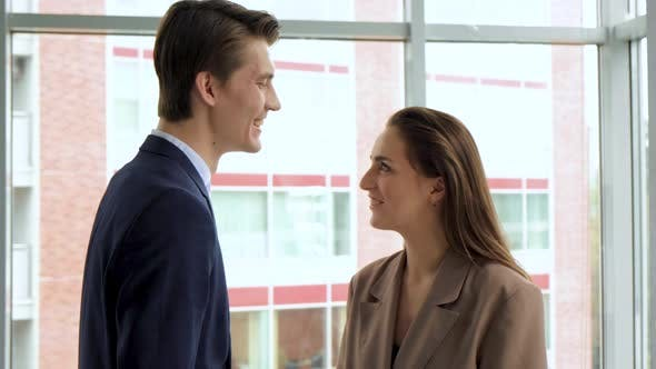 Man and woman nose to nose looking at each other in love romantic moment