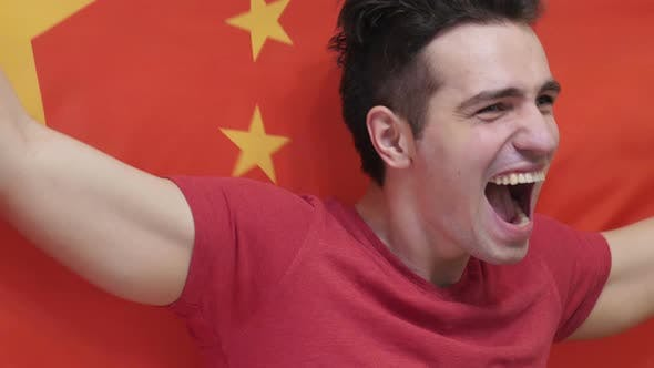 Thumbnail for Chinese Young Man Celebrating while Holding the Chinese Flag