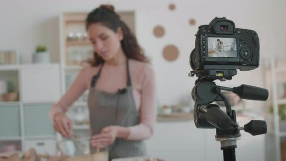 Thumbnail for Camera Filming Blurred Culinary Vlogger