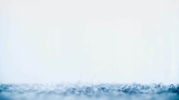 Thumbnail for Water Flow With Lot of Droplets and Splashes on Clean White Background in Shower