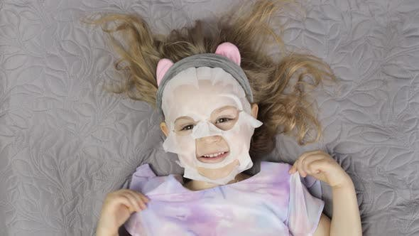 Thumbnail for Teen Girl with Moisturizing Face Mask. Child Kid Take Care of Skin with Cosmetic Facial Mask