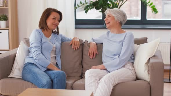 Thumbnail for Senior Mother Talking To Adult Daughter at Home
