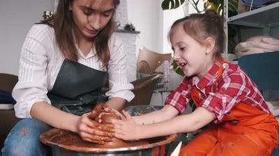 Ceramic Artist Teaching Kid How To Create Ceramics