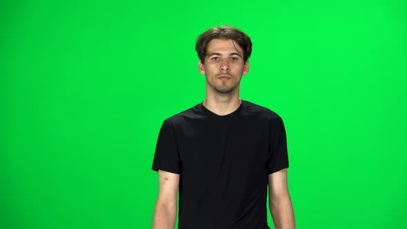 Thumbnail for Brunette Man Walking on a Green Screen. Slow Motion