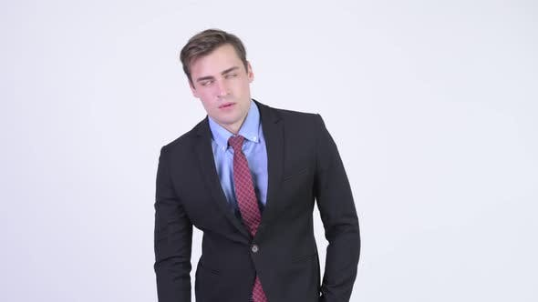 Thumbnail for Young Tired Businessman Looking Bored
