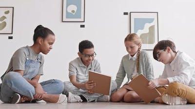 Children Studying on Floor of Museum
