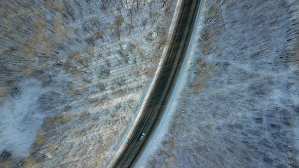 Thumbnail for Car On The Winter Forest Road From Above