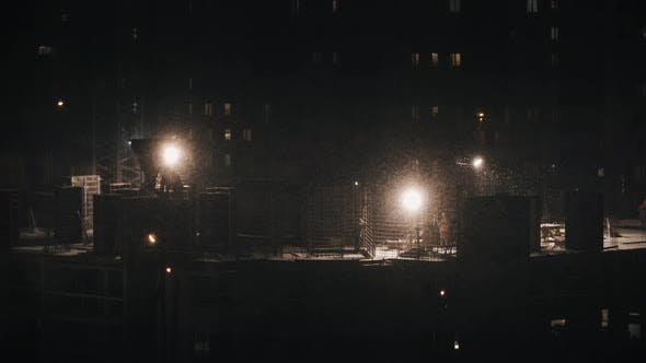 Cover Image for Construction Site Residential Building, Workers Construct at Winter Night in Bad Weather Conditions