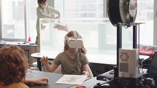 Schoolgirl Wearing VR Glasses in Lab in School