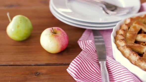 Thumbnail for Close Up of Apple Pie and Knife on Wooden Table