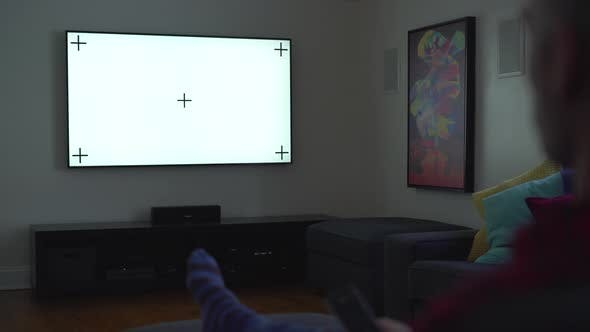 Thumbnail for Man Watching TV in a Dark Room