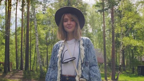 Pretty Woman In Forest Posing