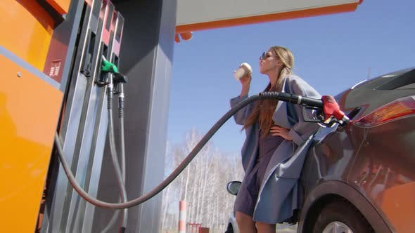 Cover Image for Elegant Woman at Gas Station