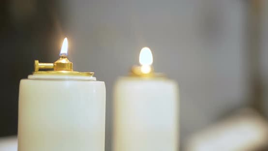 Thumbnail for Few Lit Candles In Church